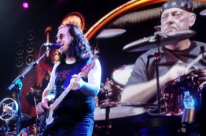 Neil Peart looks on stoically as Geddy Lee sings the words that he wrote.